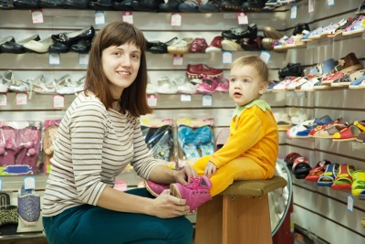 baby in shoe store