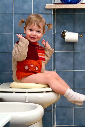 happy girl on a potty seat